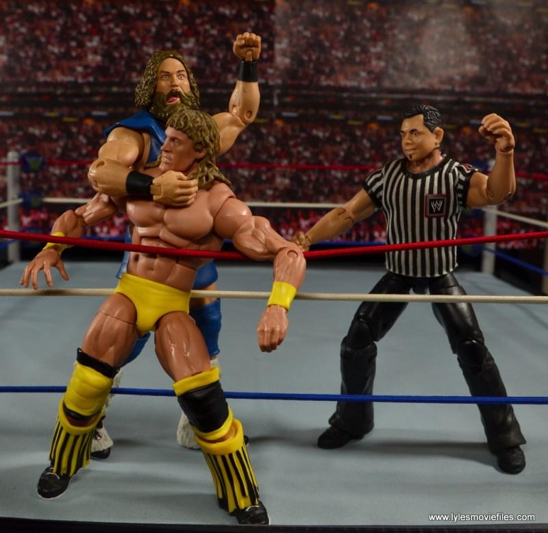 WWE The Berzerker figure review - clubbing Texas Tornado