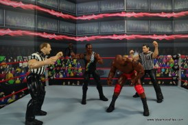 WWE Elite Farooq and The Rock Nation of Domination figure review set - Farooq whipping Ahmed Johnson
