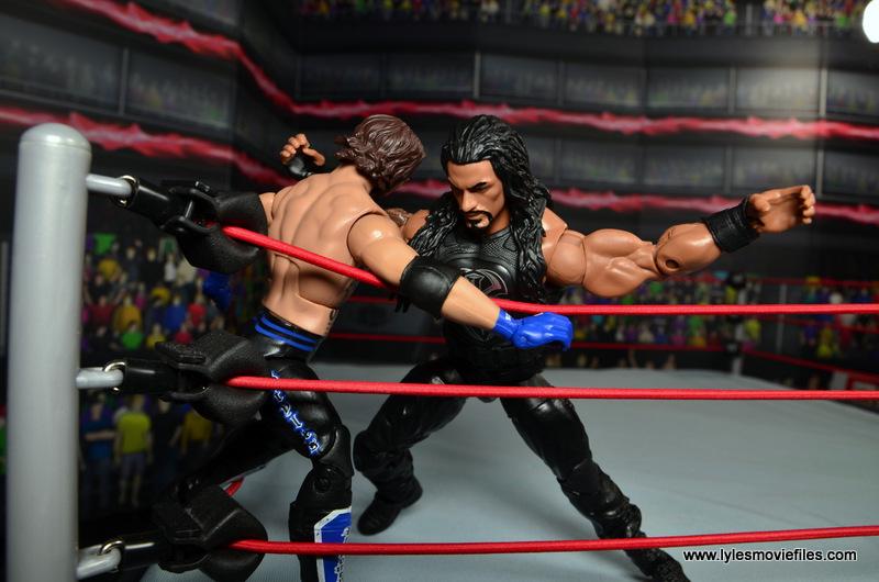 WWE Elite 45 Roman Reigns figure review - corner splash to AJ Styles