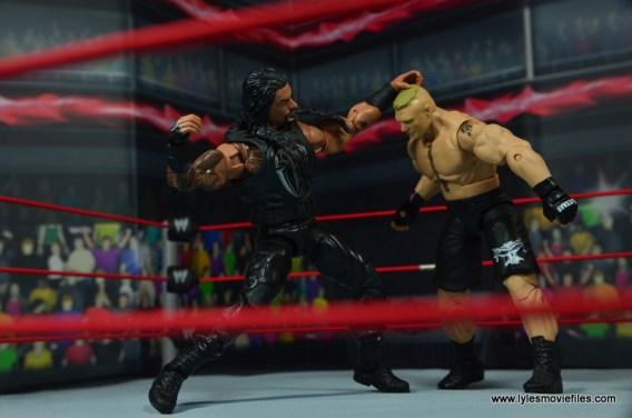 WWE Elite 45 Roman Reigns figure review - punching Brock Lesnar