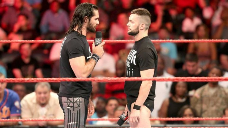 Seth Rollins face off Finn Balor