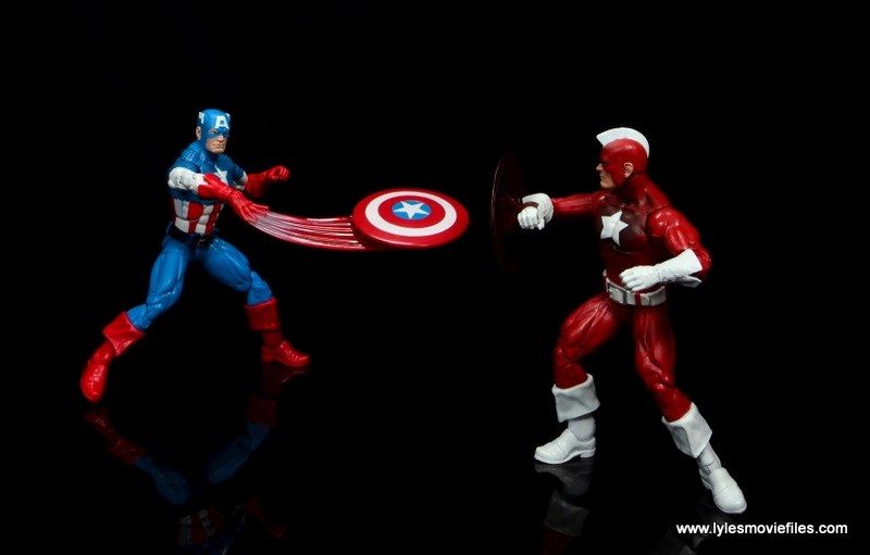 marvel legends retro captain america figure review - slinging shield at red guardian