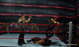 wwe elite 47b kane figure review -choking out roman reigns