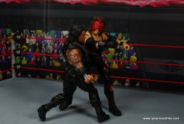 wwe elite 47b kane figure review -punching roman reigns