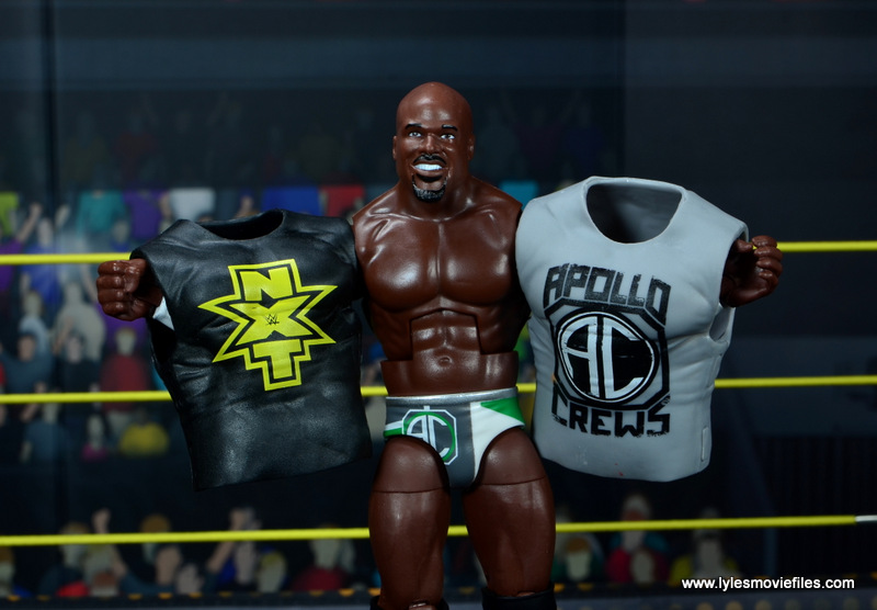 wwe elite 49 apollo crews figure review - holding up both shirts