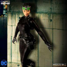 mezco catwoman figure against a wall