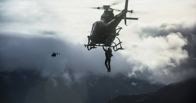 mission-impossible-fallout-review-ethan-on-a-helicopter.