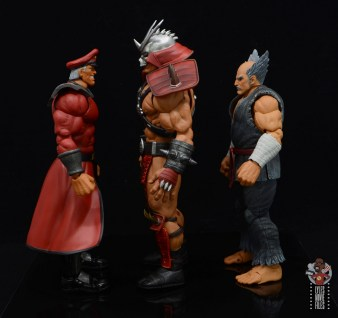 storm collectibles mortal kombat shao khan figure review - facing m. bison and heihachi mishmai