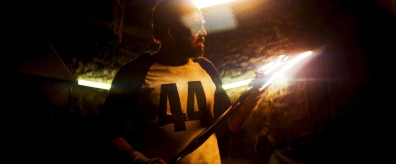 mandy movie review - red with his weapon