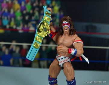 WWE Flashback Ultimate Warrior figure review -holding title up