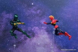 marvel legends genis-vell figure review - aiming blaster at captain marvel