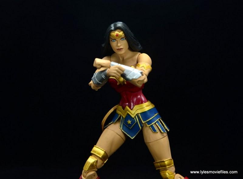 DC Essentials Wonder Woman figure review - bringing bracelets up
