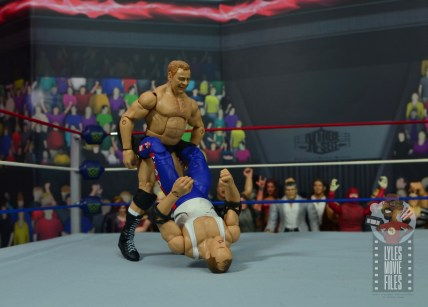 wwe elite pat patterson figure review - about to slingshot sgt slaughter into ropes