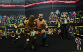 wwe elite 65 eric young figure review - clothesline to adam cole