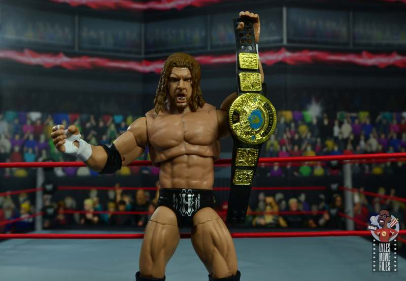 wwe ultimate edition triple h figure review -holding up the title