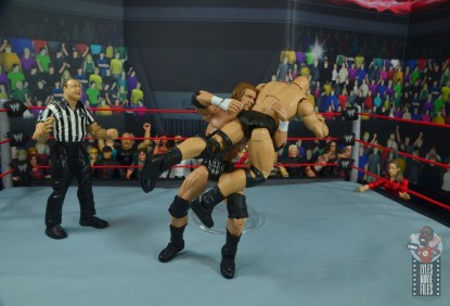 wwe ultimate edition triple h figure review - spinebuster to stone cold steve austin