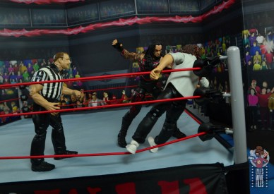 wwe hall of champions undertaker figure review - beating down manking in the corner