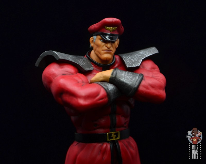 storm collectibles street fighter m. bison figure review - arms crossed right