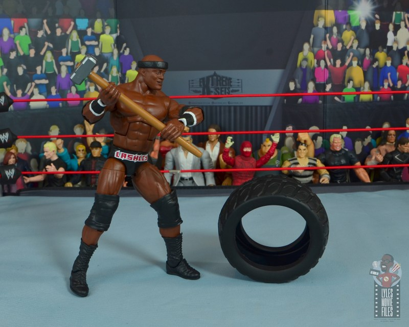 wwe elite 69 bobby lashley figure review - swinging sledgehammer on tire