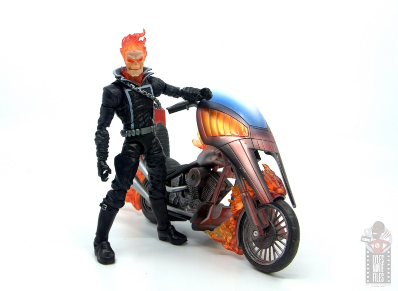 marvel legends ghost rider figure review - standing next to motorcycle