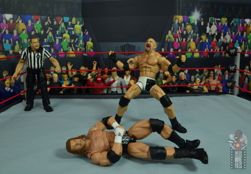 wwe elite #74 goldberg figure review - standing over triple h