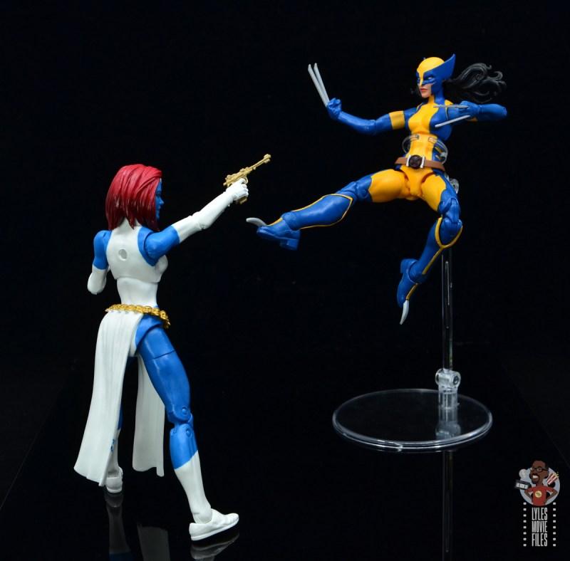 marvel legends wolverine figure review - kicking mystique