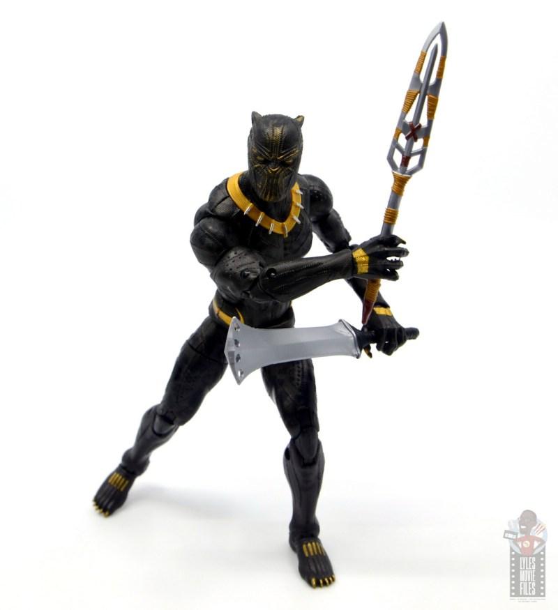 marvel legends erik killmonger figure review - advancing with weapons