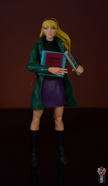 marvel legends retro gwen stacy figure review - holding books