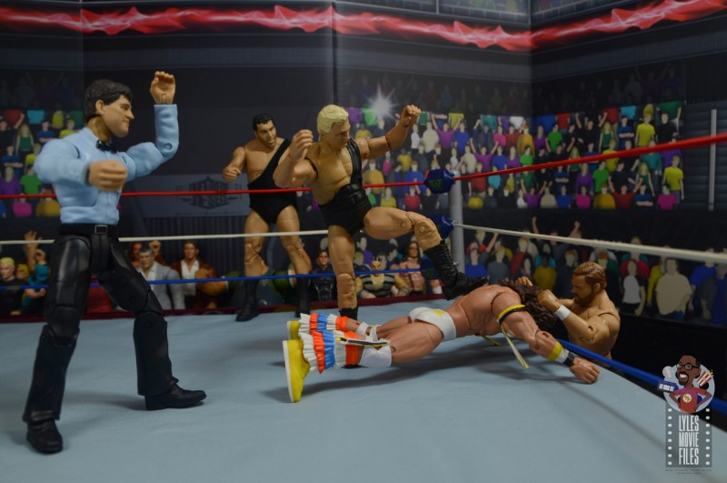 wwe legends 7 bobby the brain heenan figure review - heenan family taking out ultimate warrior