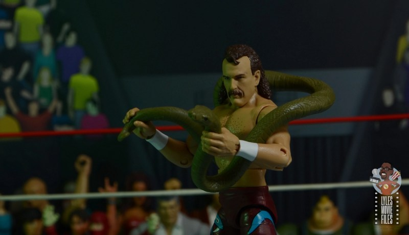wwe legends 8 jake the snake roberts figure review - holding damien