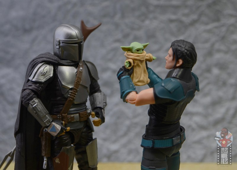 star wars the black series the child figure review - getting held by cara dune