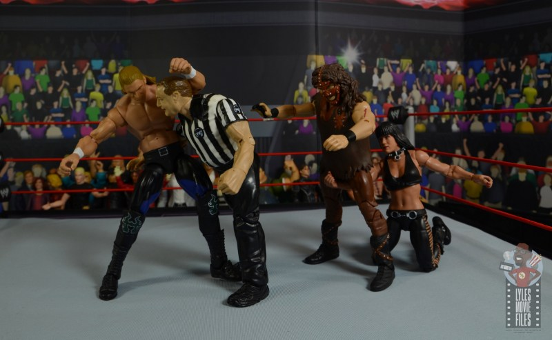 wwe triple h and chyna figure set review - triple h grabbing the ref