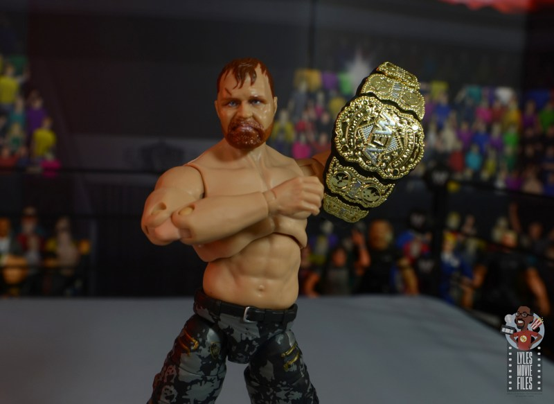 aew unrivaled jon moxley figure review -holding up the AEW title