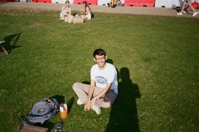 Daanyaal sitting on grass