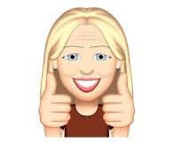 L'émoji de Lynda Dionne souriante avec les 2 pouces en l'air