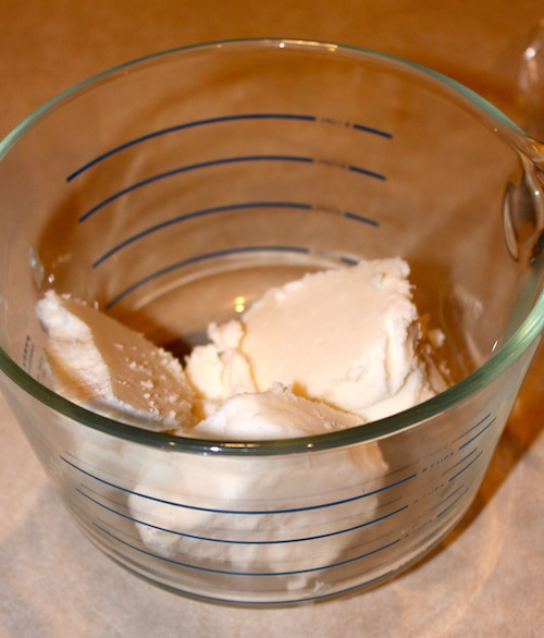 Shea butter in glass container