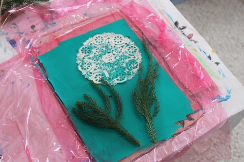 Pine and doily on printing plate