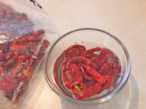 Dried tomatoes soaking in hot water