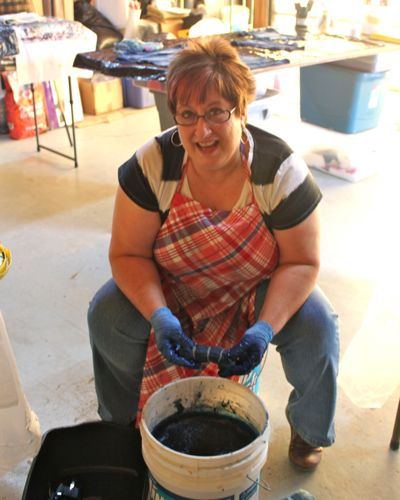 Kathy Sands playing in the indigo dye