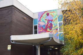 Mural over the school entrance at Grand Ave.