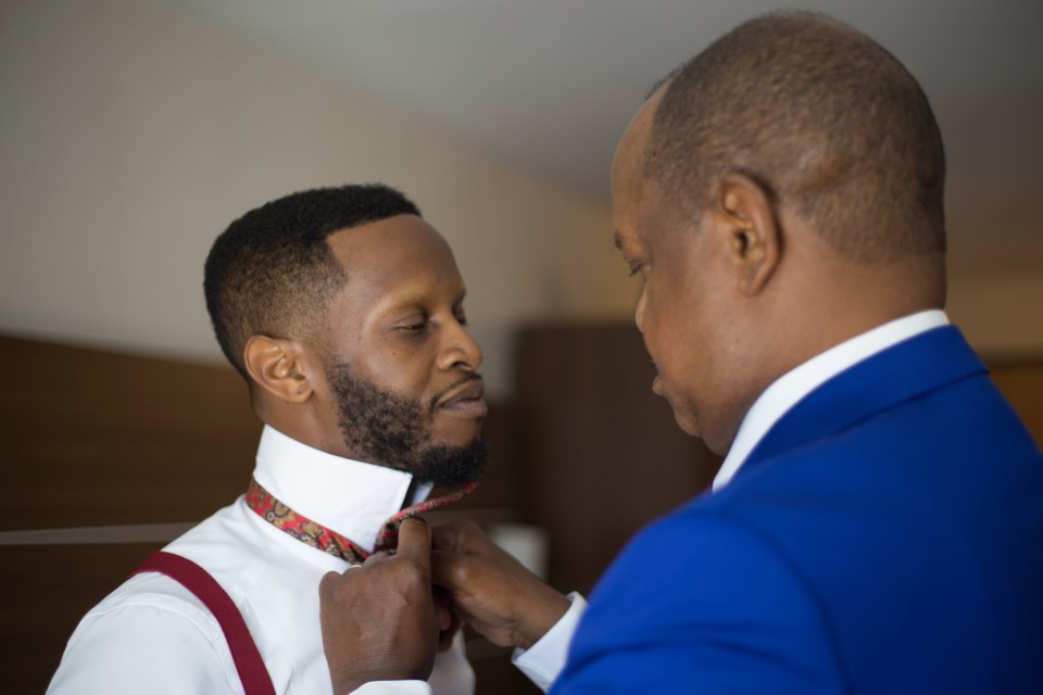 The father of the groom share a tender moment with the groom right before the ceremony