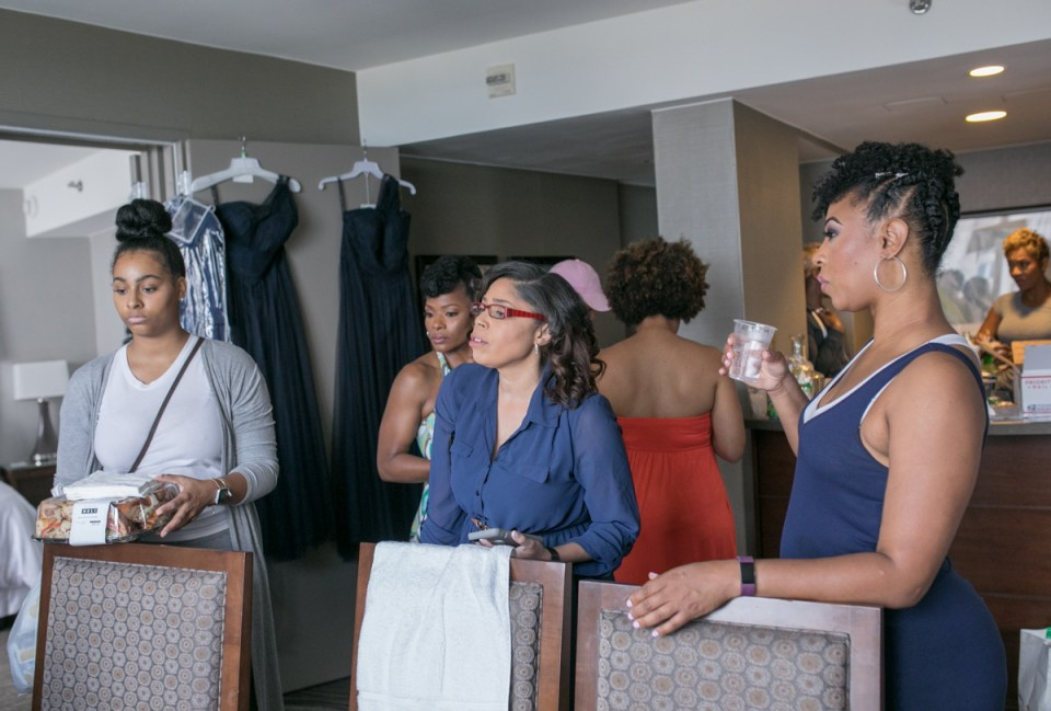 The bridesmaids gathering together during bridal prep