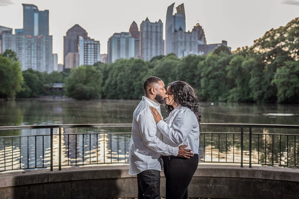 Happy couple holding hands during their Piedmont Park  engagement session.