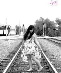 looking down railroad pose black and white WM