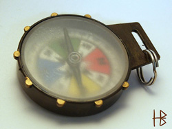 image of a compass with a clouded glass