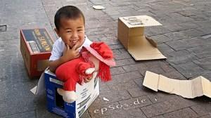 boy playing in box