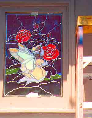 stained glass project being mounted in the window, viewed from the outside