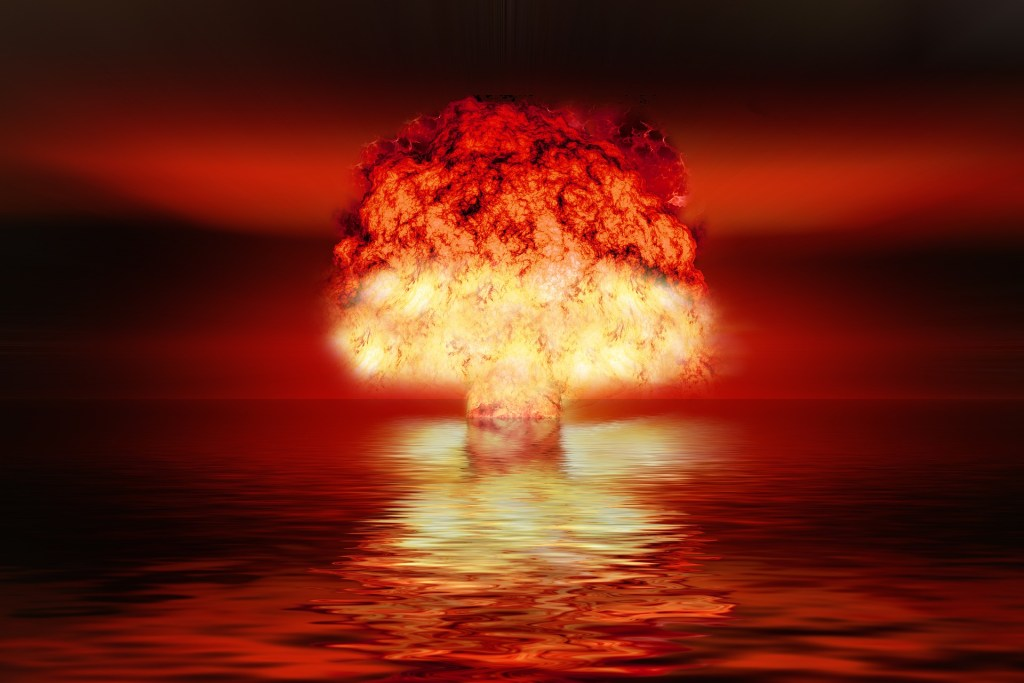 photograph of an atomic bomb explosion at sea