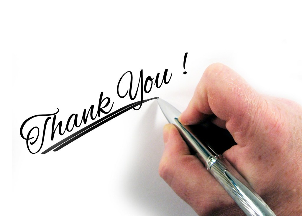 When I can't and it's okay I have you to thank. Image is a hand holding a pen writing Thank You!