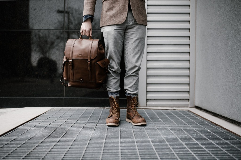 Image of traveller carrying a bag--is he or she ready? How long would you survive on what you packed?